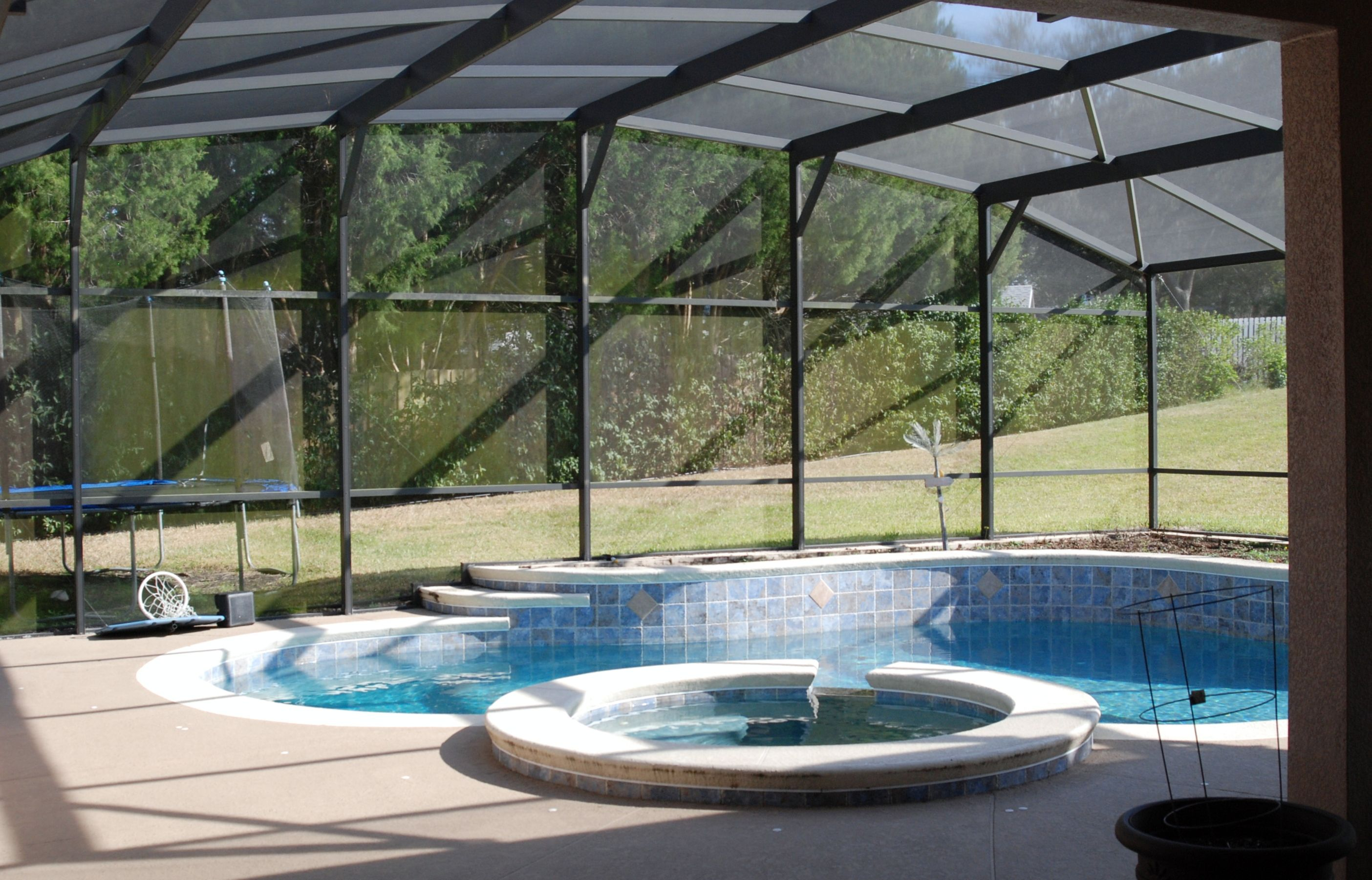 screen enclosed pool and