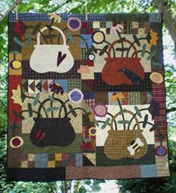 Scrappy wall hanging pattern for Spring. May Baskets Quilt Pattern Pattern CYQ-188 by Country Quilts - Cheryl Wall.  Check out more of our quilt patterns. https://www.pinterest.com/quiltwomancom/quilts/  Subscribe to our mailing list for updates on new patterns and sales! http://visitor.constantcontact.com/manage/optin?v=001nInsvTYVCuDEFMt6NnF5AZm5OdNtzij2ua4k-qgFIzX6B22GyGeBWSrTG2Of_W0RDlB-QaVpNqTrhbz9y39jbLrD2dlEPkoHf_P3E6E5nBNVQNAEUs-xVA%3D%3D