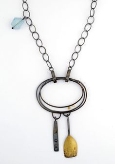 """by Sydney Lynch, With its sculptural, balancing elements, the Vida necklace is crafted in oxidized sterling silver, 18k & 22k gold on a 28 inch chain with an aquamarine bead. Custom lengths available upon request. Pendant element measures 3""""L x 1.75""""W. Dimensions: 3″H, 1.75″W, 28″L"""