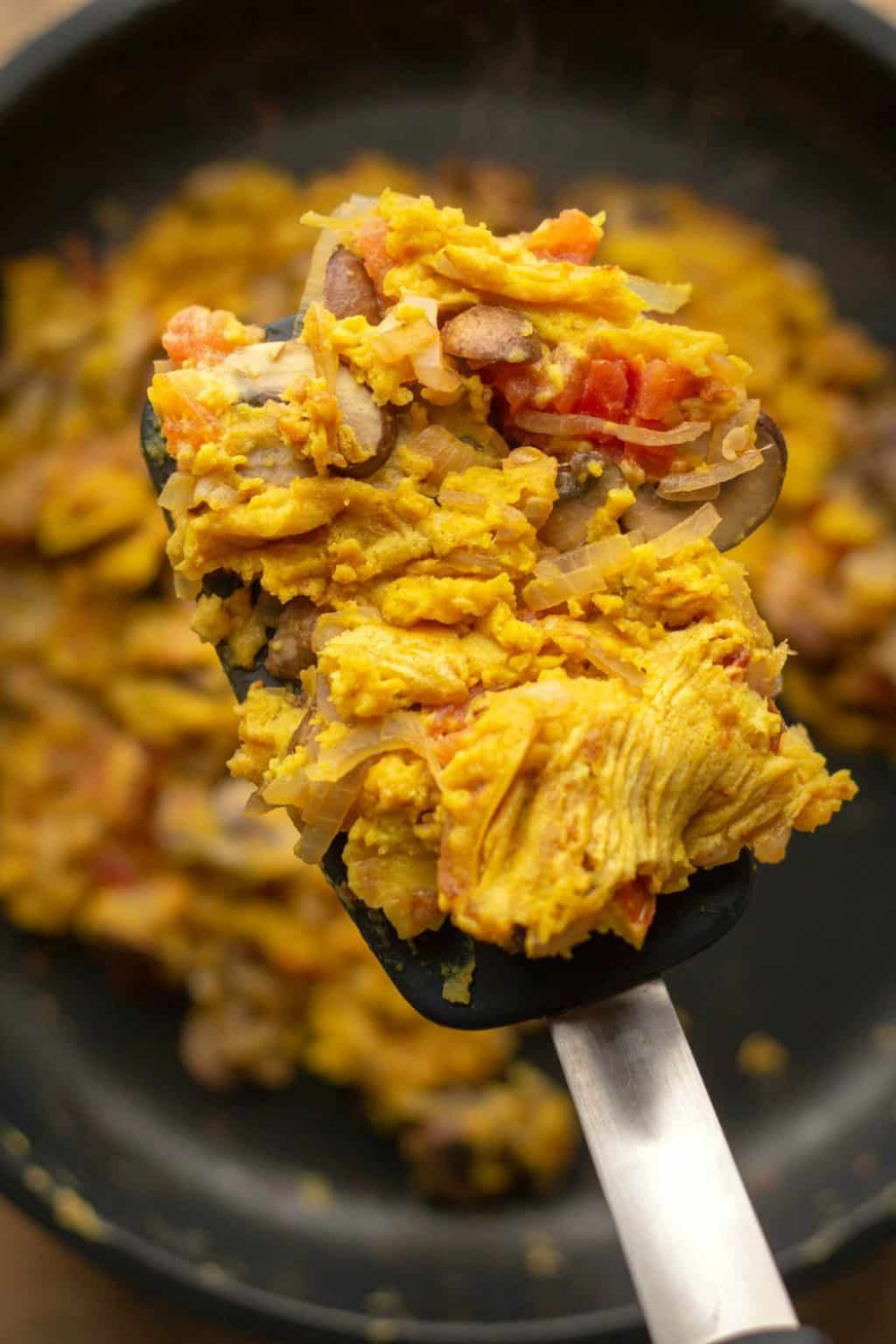 vegan scrambled eggs are made with chickpea flour instead of tofu for a filling and high protein breakfast scramble. |