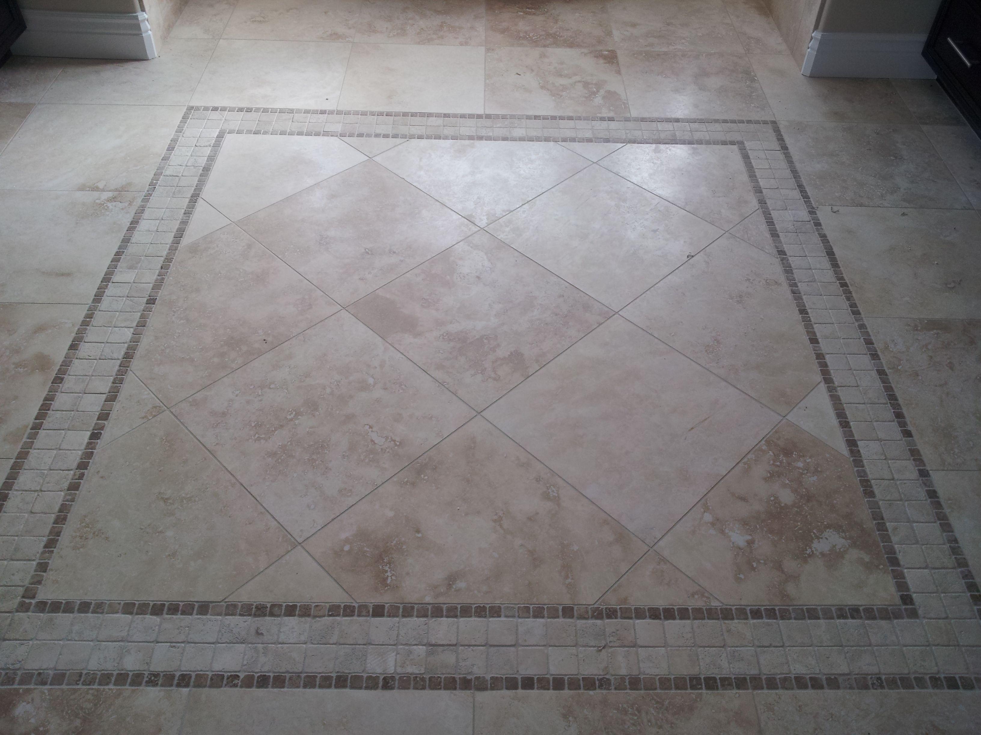 Travertine 18 X 18 Tile Rug In Master Bathroom To Learn More Visit Us At Www Capellinteriors Com Entry Tile Tile Rug Hallway Flooring