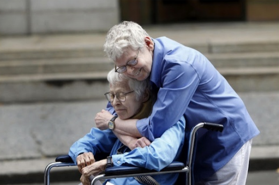 Phyllis Siegel, 76, left, and Connie Kopelev, 84, both of New York, embrace after becoming the first same-sex couple to get married at the Manhattan City Clerk's office in 2011.
