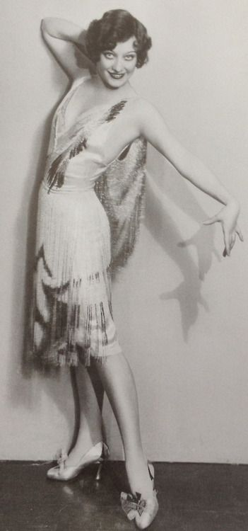 Joan Crawford 1928  Joan Crawford seen here in an Adrian lamé and bugle-beaded Deco detail costume for the Cedric…