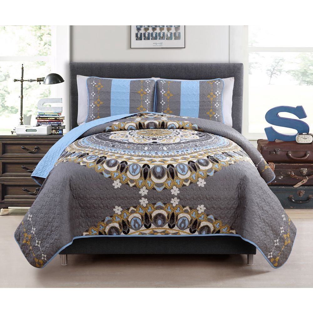 Add a bohemian vibe to your bedroom with this medallion styled reversible quilt set.