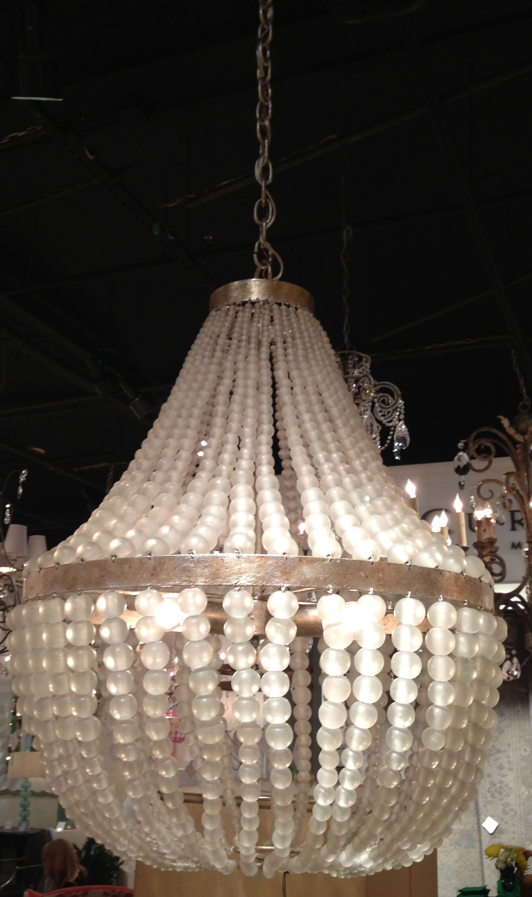 http://pinterest.com/stylespotfall12/stacy-naquin/  You may have seen colored versions of this chandelier, but the new frosted glass is stunning *and* versatile.  Simply spectacular and sure to be a best seller!  Currey & Co. (IHFC - M110) #hpmkt #stylespotters