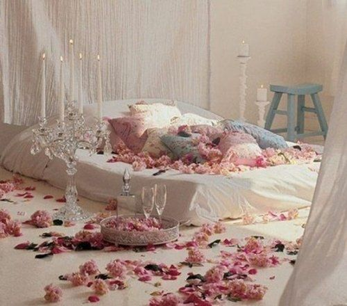 Creative Ideas Fascinating Wedding Romantic Bedroom With Florals And Pillows On King Size Bed Candlesticks Also Blue Chair White Curtain 10 To