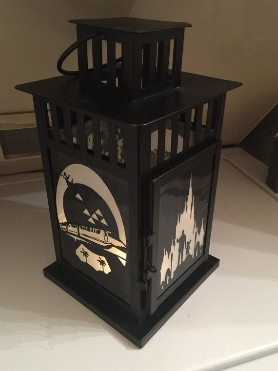 Beautifully upcycled portable lantern inspired by the Disney World Parks. Featuring one of a kind laminated handcut cardstock and frosted paper