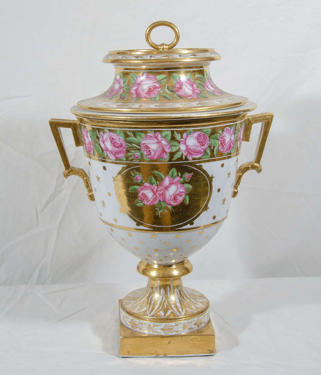 A pair of exceptional Spode ice pails large, richly gilded and beautifully painted with pink roses and green leaves on a gold ground. Ice pails were commonly placed on the sideboard and used as fruit coolers, often for serving iced cream with the fruit (also called fruit coolers). They were the 18th and 19th century equivalent of today's ice cream maker.