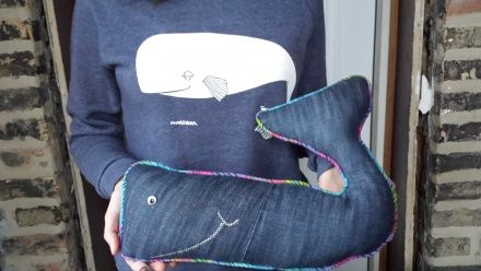 Upcycle an old pair of jeans into a happy lil' whale pillow