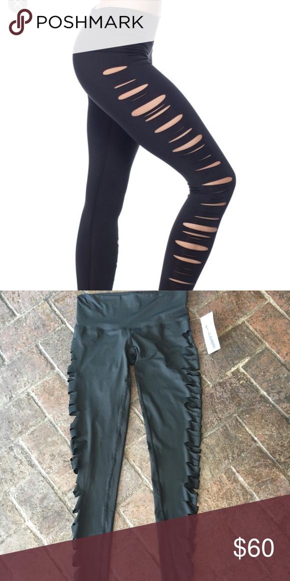 3b651c660cebd Teeki Jimi Hot Pant Mid rise full length leggings made from recycled water  bottles. Black, size small, ripped detail down side teeki Pants Leggings