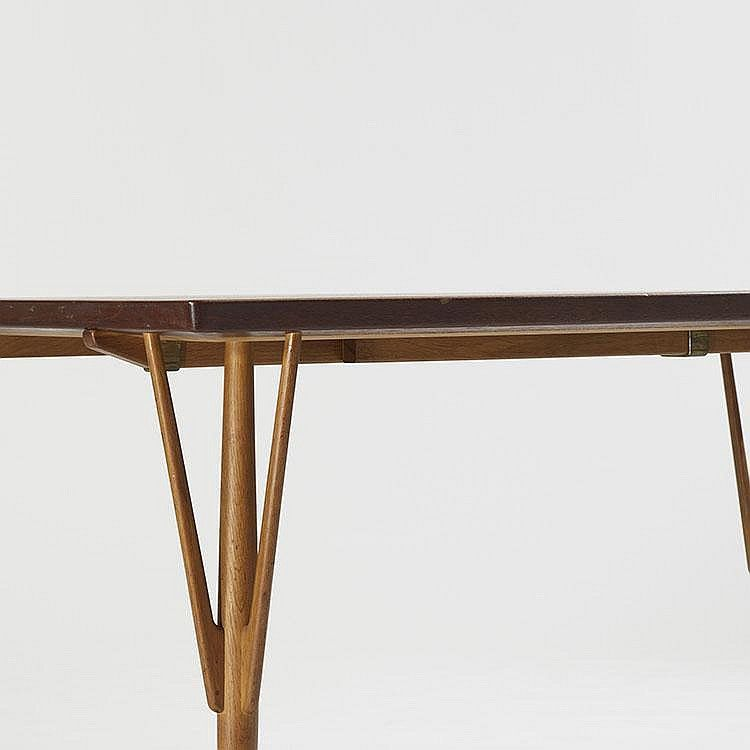 Hans Wegner rare dining table  Johannes Hansen  Denmark, 1949  teak, oak, brass  62.75 w x 37 d x 30 h inches  Sold with two 18.75-inch leaves; table measures 100.5 inches when fully extended. Signed with impressed manufacturer's mark to underside: [Johannes Hansen Copenhagen Denmark]