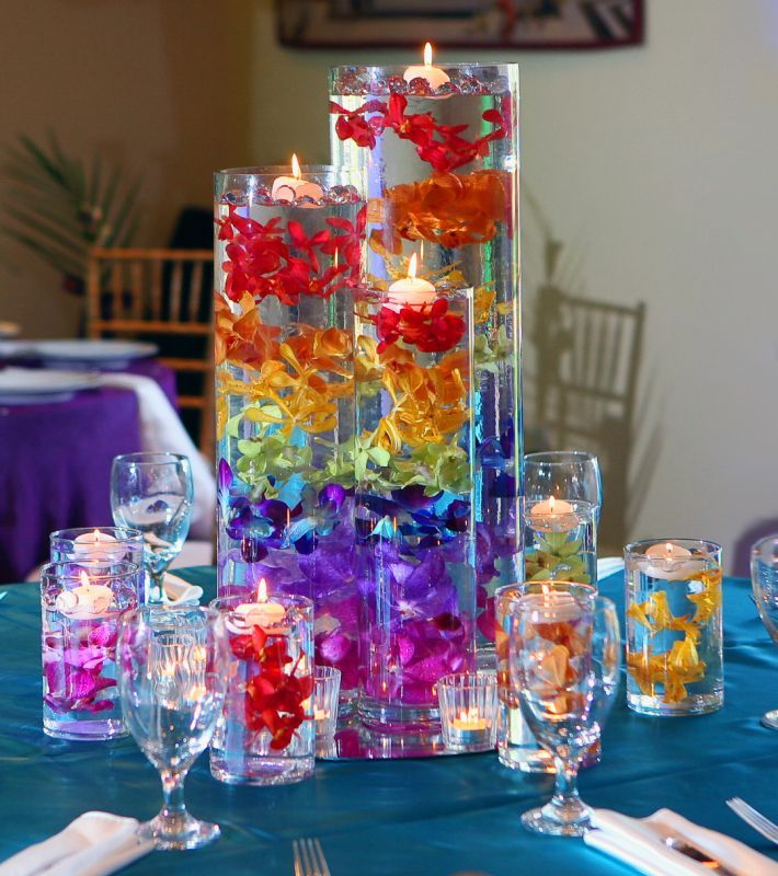 Modern rainbow flower and candle centerpiece arrangement for Modern centerpieces