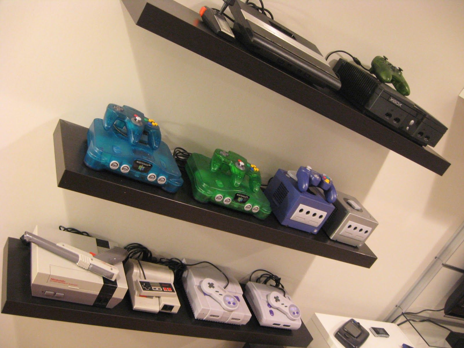 Are you looking for some amazing game room ideas? Gaming Consoles on floating shelves - game room via ...