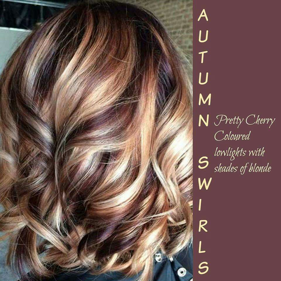 Pretty cherry colored low lights with shades of blonde hair