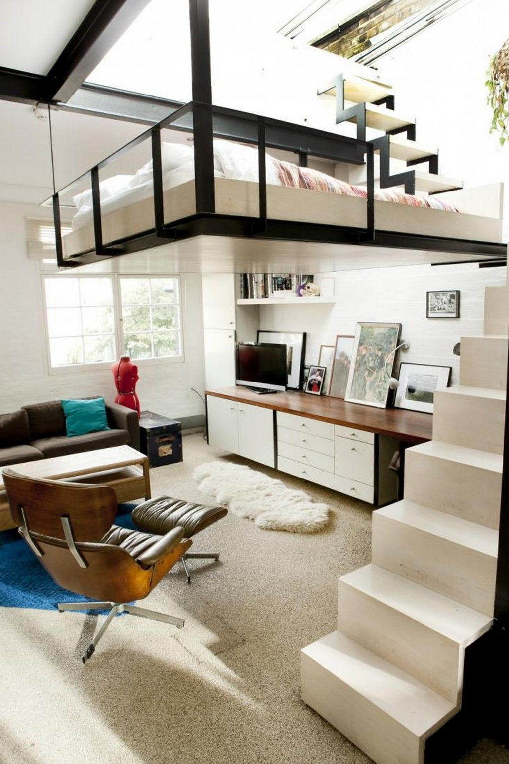 white small staircase leading to the suspended bedroom above modern compact living room design. Black Bedroom Furniture Sets. Home Design Ideas