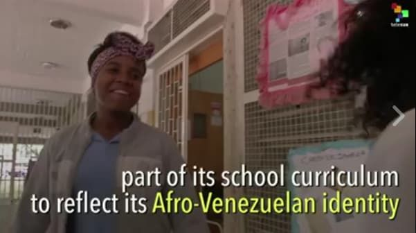 TeleSurTV investigates the rich history of Afro-Latinos living in the Venezuelan town of San Agustin. The video shows students learning about African music, dance and history all the while preparing for a revolution.San Agustin is revolutionary because it has created a school curriculum that is entirely focused on Black history. Members of the town …