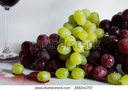 Red and white grapes on white