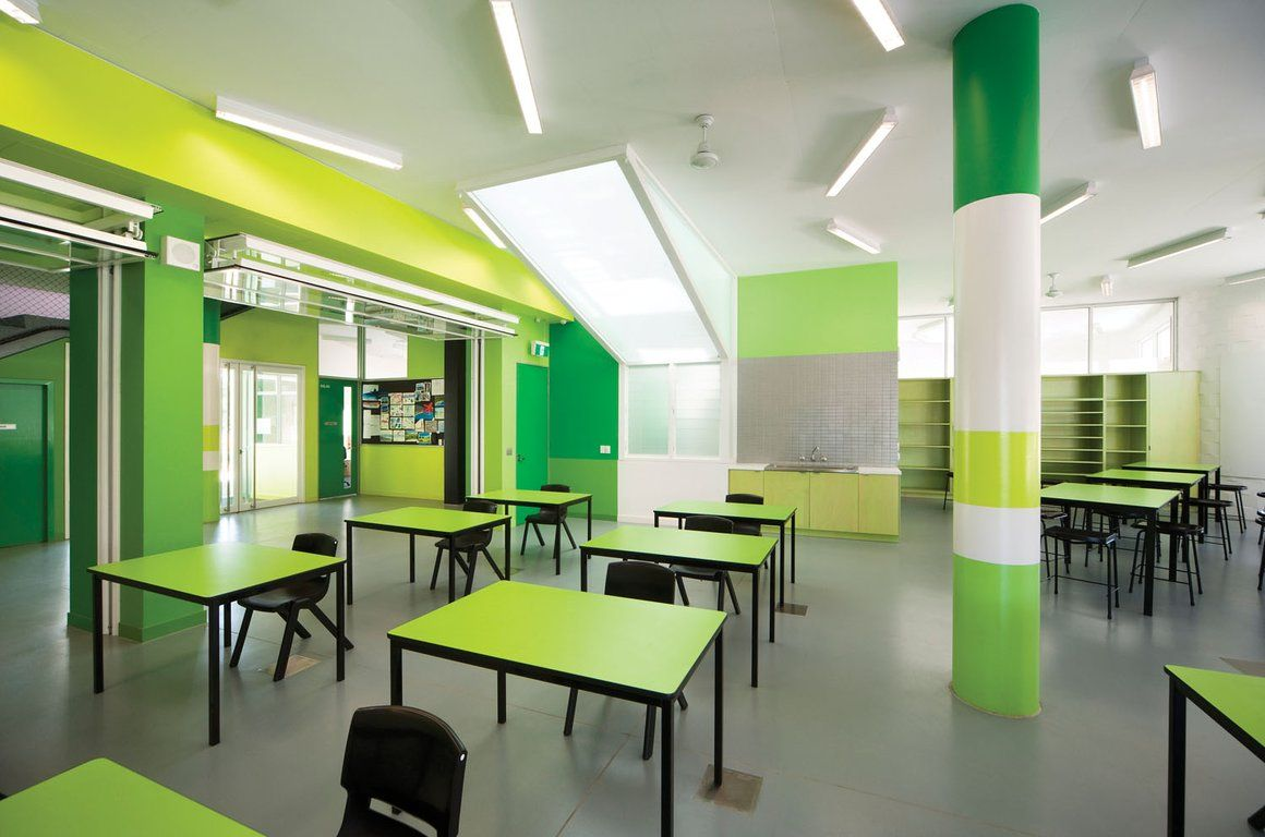 Wonderful Clasroom Applying Green Room Color Of Interior Design School With Desk Completed Black Chairs