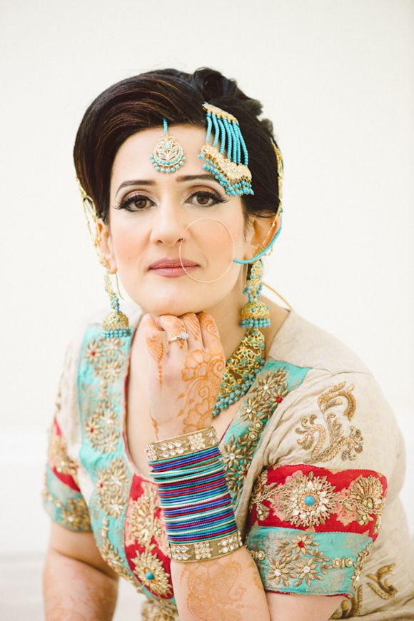 A UK Muslim Wedding with colours of turquoise blue, red and gold