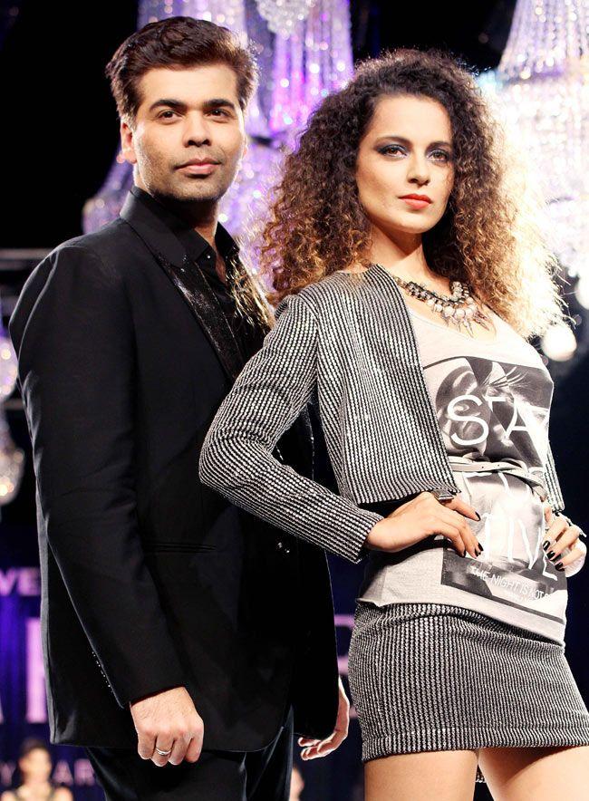 Karan Johar and showstopper Kangana Ranaut strike a pose on the ramp. #Bollywood #Fashion #Style #Beauty