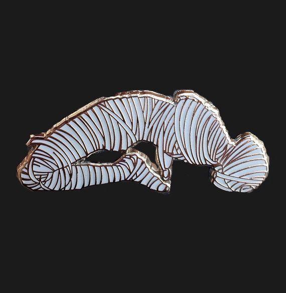 mummified alive enamel pin