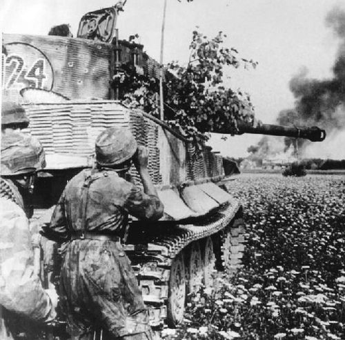 German paratroopers behind a Tiger I tank in combat by GLORY. The largest archive of german WWII images, via Flickr
