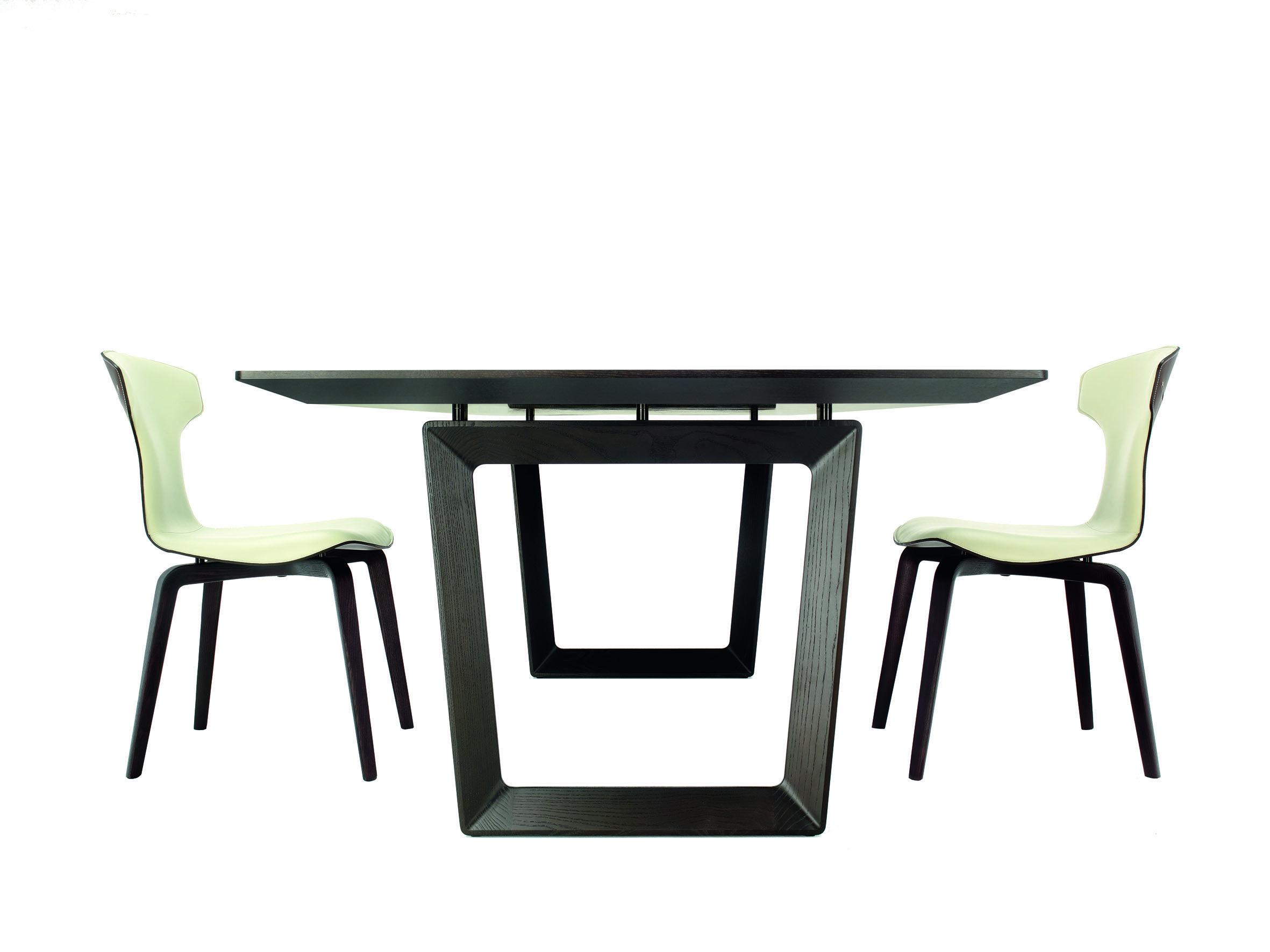 Roberto lazzeroni has designed the bolero table sleek for Sleek dining table designs