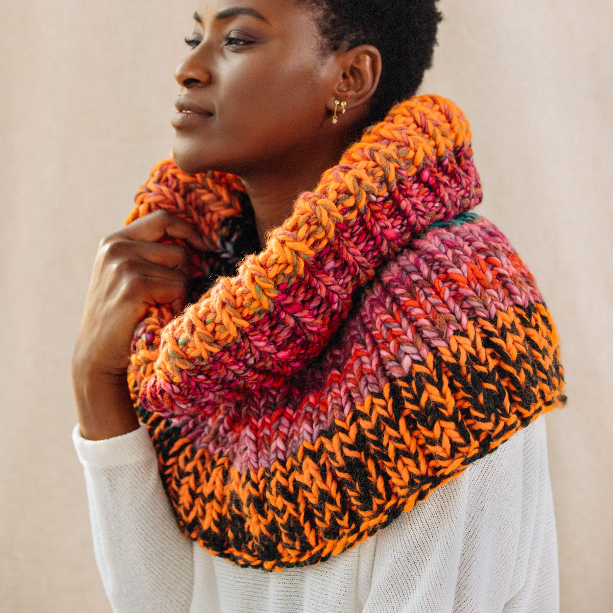 The ultimate never-taking-this-off fall accessory: a cozy knit cowl hood in bright autumnal colors.