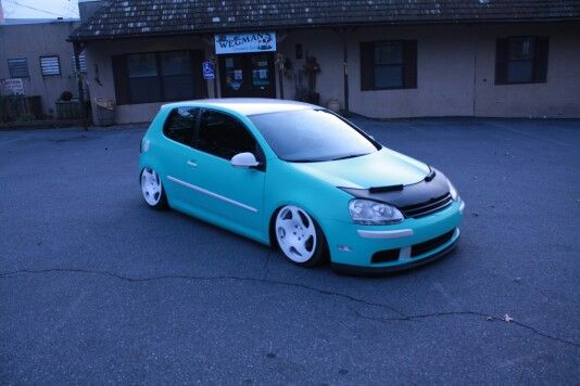 A mkv vw rabbit on air suspension vinyl wrapped in mint
