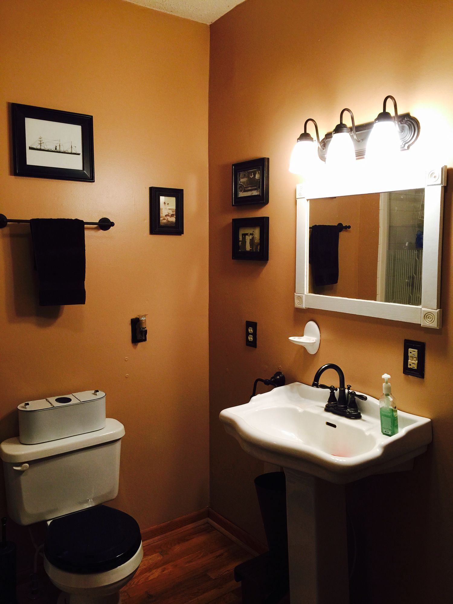 Old family photos make great bathroom decor in an old