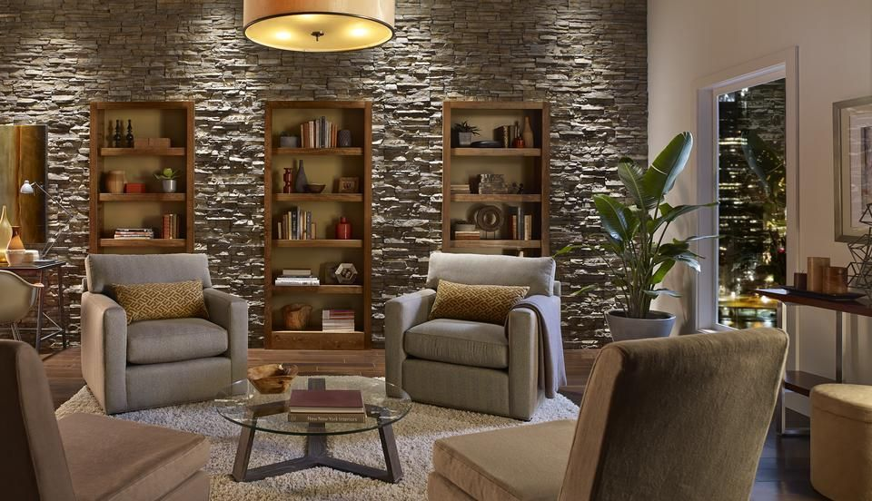 Contemporary stone wall built in bookcases neutral color - Stone accent wall living room ...