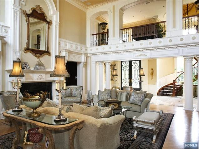 mediterranean living room with fireplace, cement fireplace, high