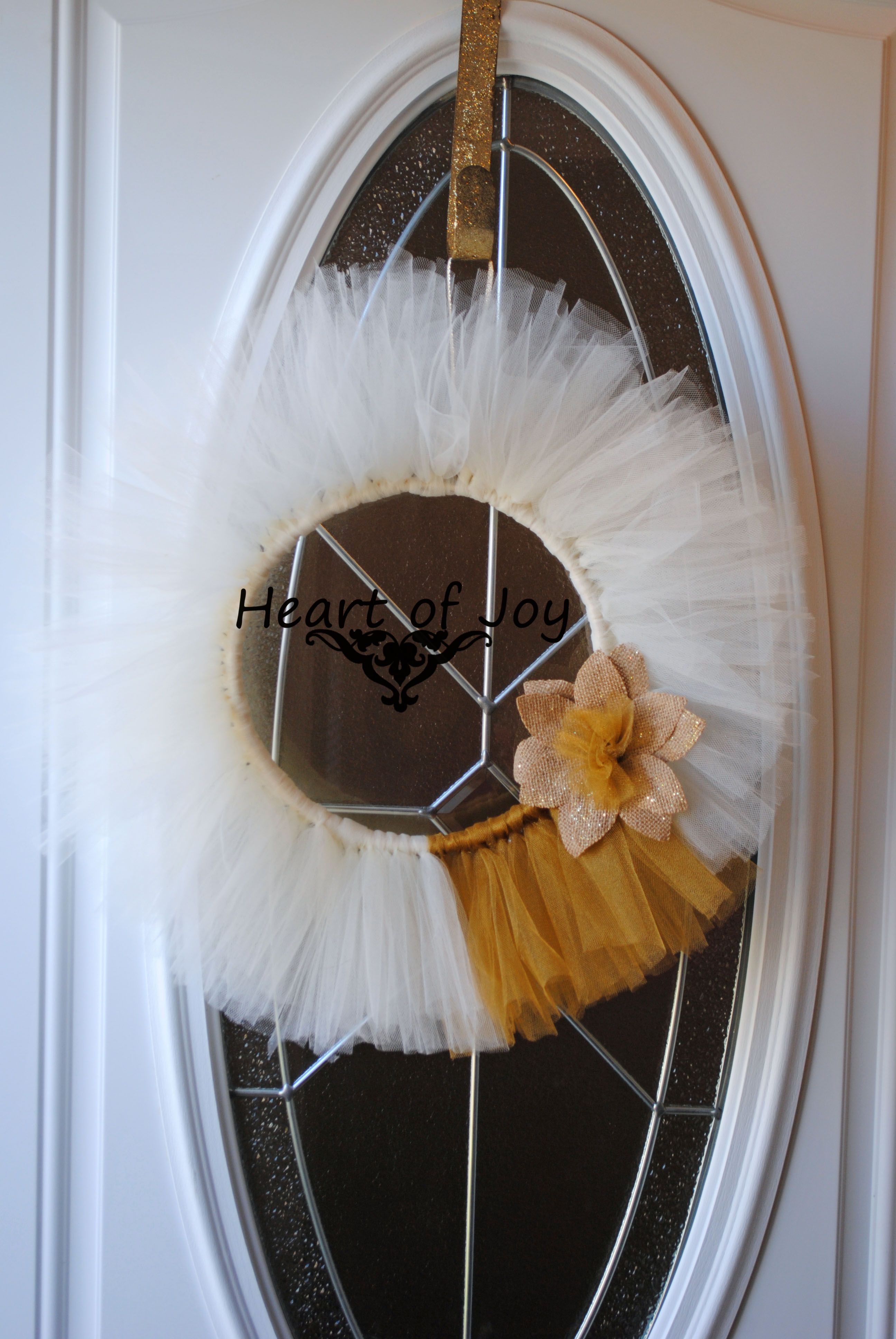 SOLD  Can be recreated if requested  $35.00 Ivory and gold tulle wreath with burlap flower embellishment www.facebook.com/myheartofjoy heartofjoycreations@gmail.com