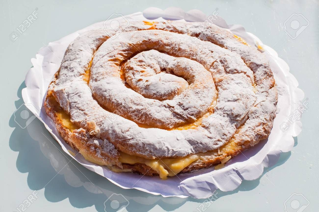 Ensaimada With Cream Spiral Shaped Pastry Typical Of Majorca Spain Affiliate Spiral Shaped Ensaimada Cream Majorca Recipes Good Food Food