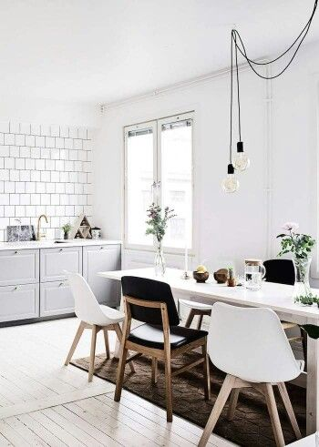 Mixed Match Chairs And Cool Dining Room Lighting