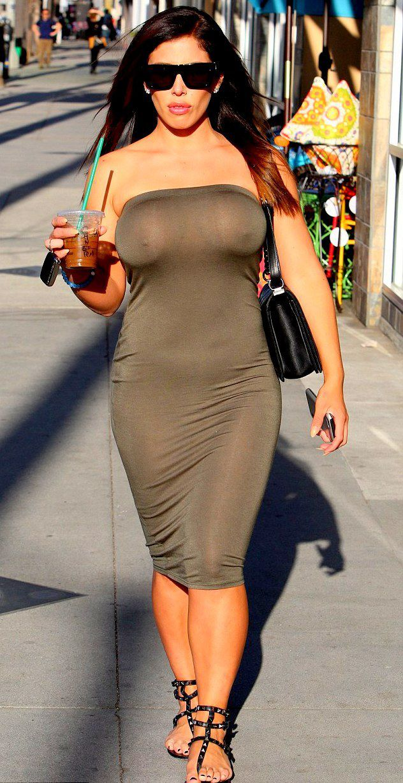 Kim kardashian flashes boobs in revealing, nearly