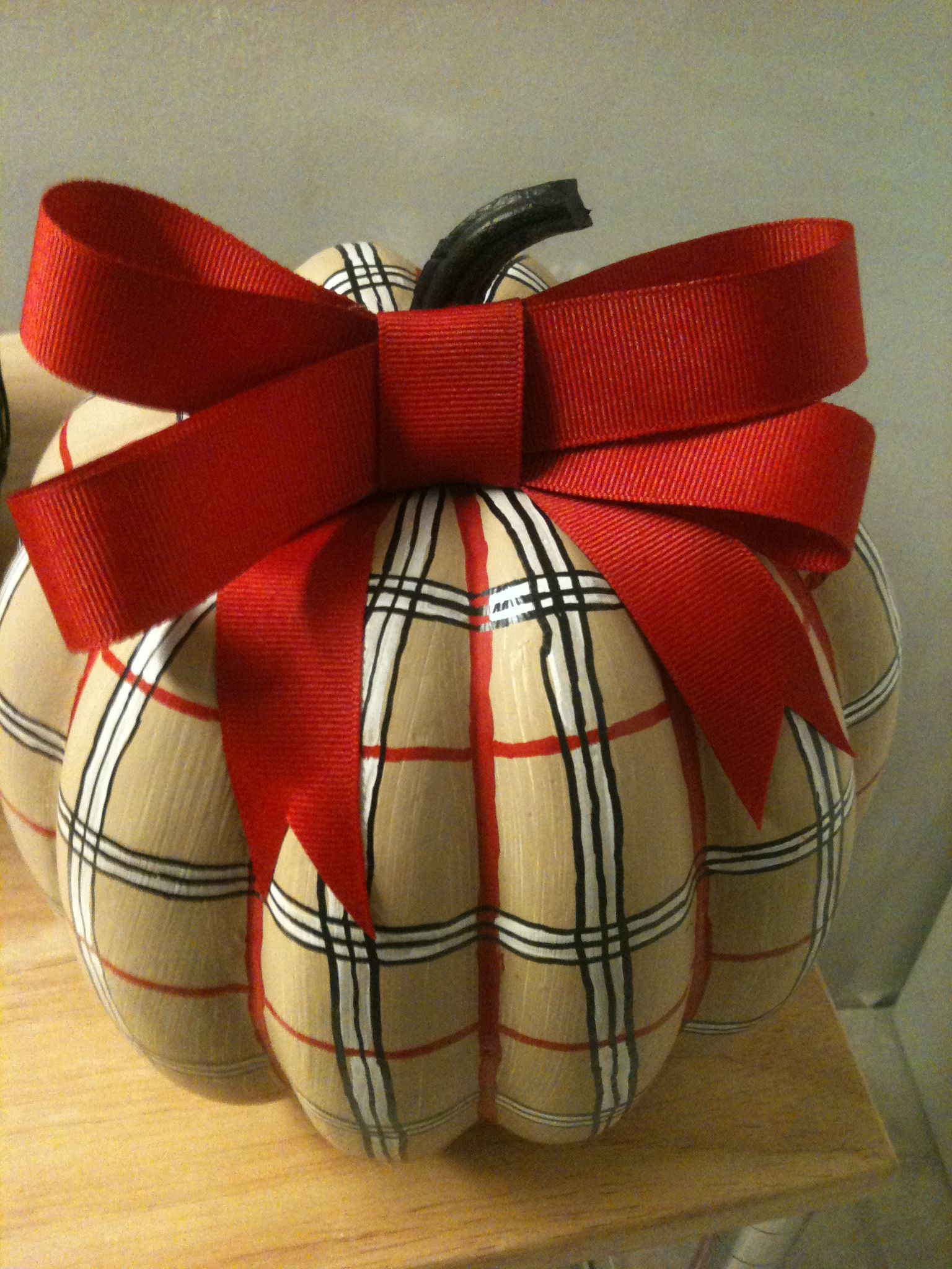 Pumpkin a la Burberry... Paint tan, use paint markers to draw the plaid pattern and add bow.