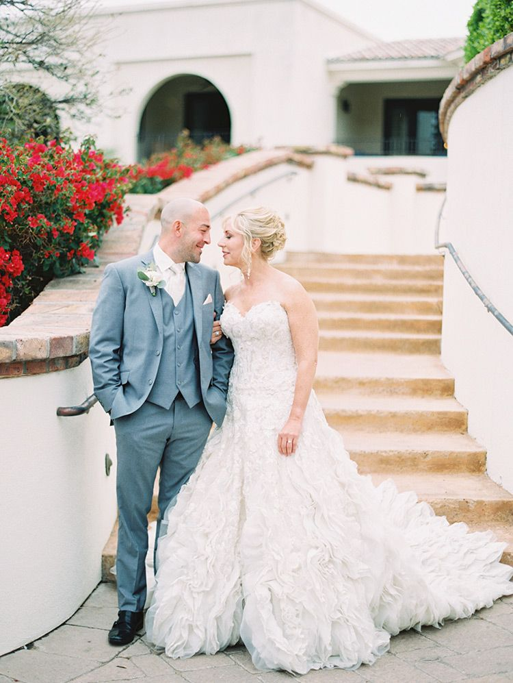 Lace Tulle Gown And A Grey Three Piece Suit