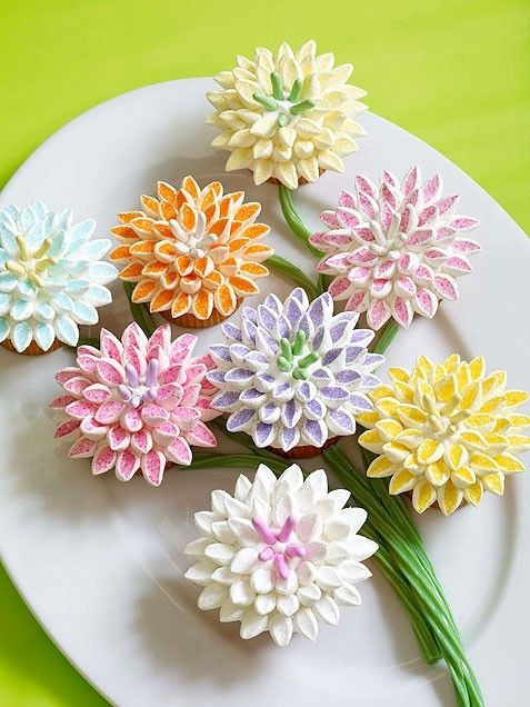 "Wow! Check out these gorgeous cupcakes: ""Think spring with these delicate flower cupcakes. The petals are easier to make than they look: Just snip marshmallows into small triangles, dip the cut side into color sugar and assemble onto an iced cupcake. Your dessert table will look like a beautiful garden of edible flowers!"" @Katie Schmeltzer Welch"