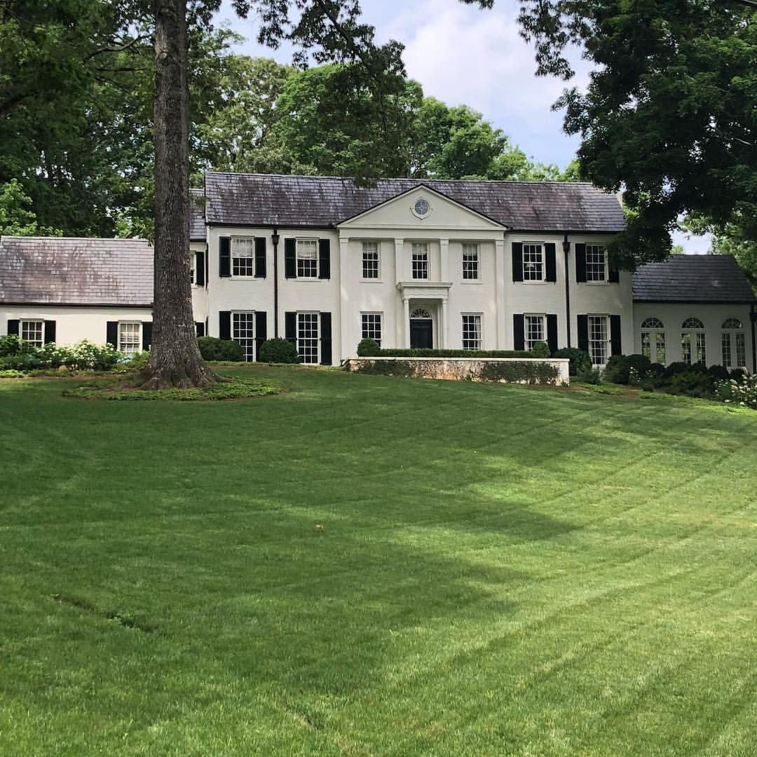 A classic big white house feels like memorial day weekend boxwoods slateroof bigwhitehouse