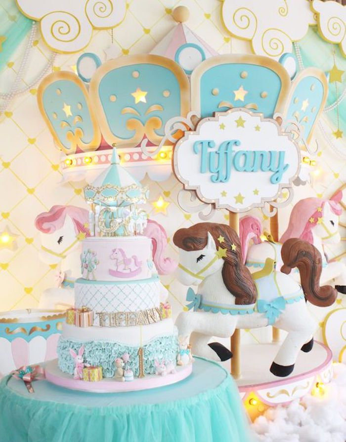 cake table from a carousel birthday party via karas party ideas karaspartyideascom