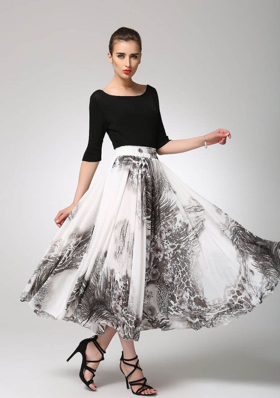 4c28431d431 This print midi skirt is created in a light weight chiffon fabric with a  black,