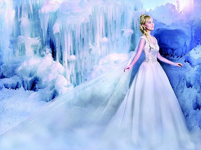 "Complete with a chapel-length Watteau train, our 2016 ""Elsa"" gown is bejeweled with metallic beading, rhinestones and sequins to glisten like ice and snow.  #disney #Elsa #fashion #Frozen #weddingdress @alfredangelobridal"