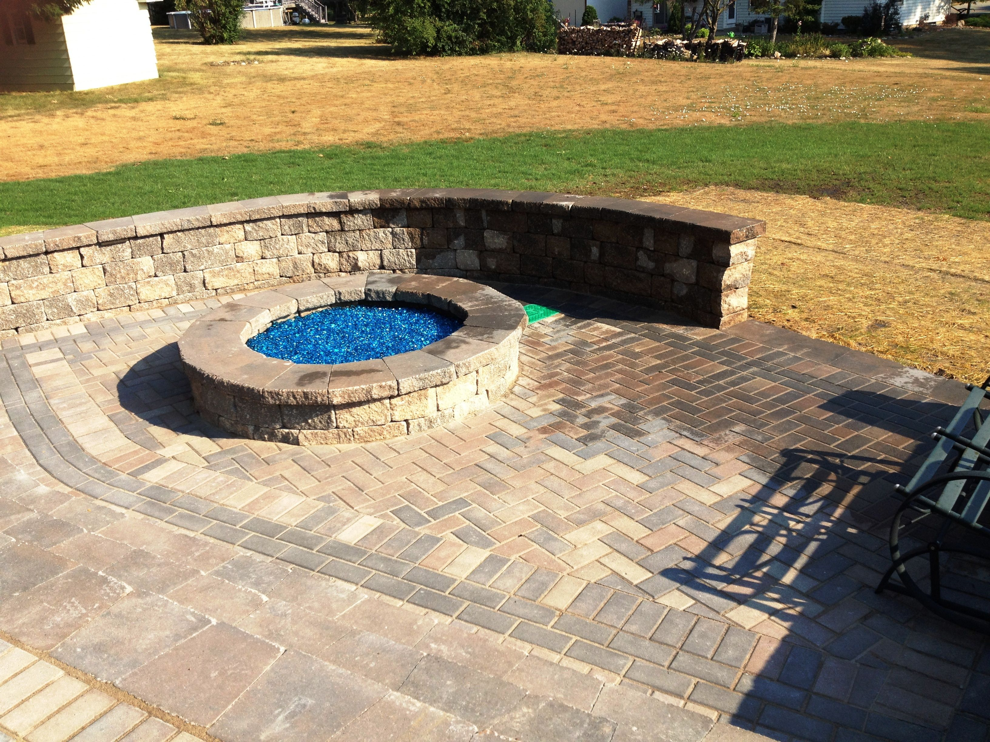 Grow Rite design - Unilock partnered with a gas firepit | Brick ...
