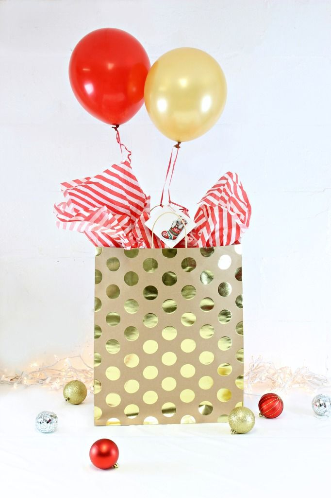 Give a Gift Card on a helium balloon inside a gift bag. When they open the gift, the balloons float up with the gift tag attached! So cute!!! Click for tutorial! #giftcardcheer #TargetHolidayGiftCard