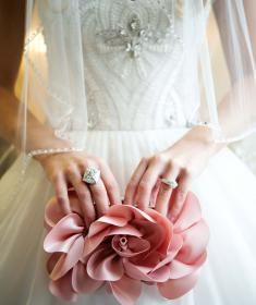 Pretty rosette clutch from Sondra Roberts available at J.J. Kelly Bridal Salon. Rings from Naifeh Fine Jewelery. Photo by Traina Photography  #rosette #pink #clutch