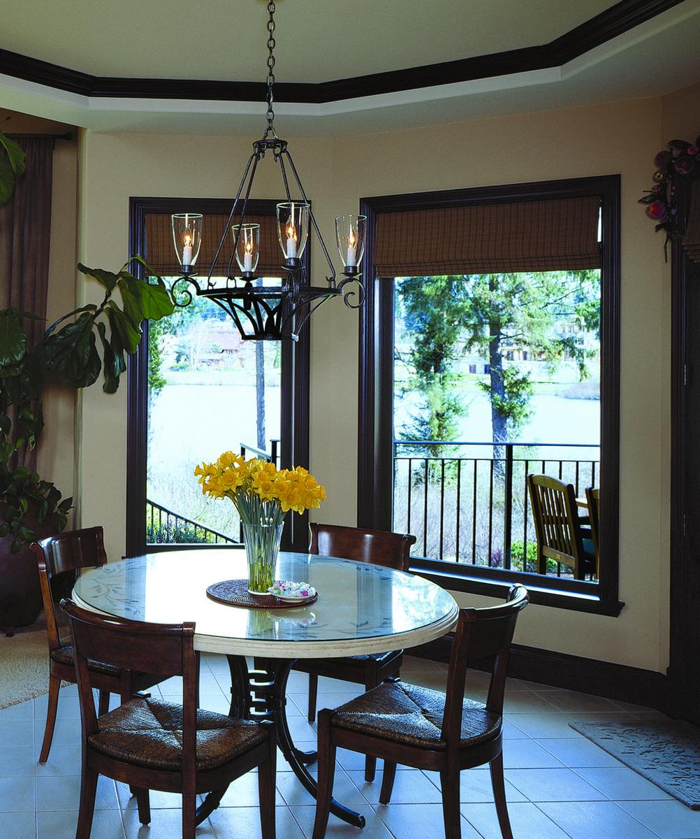 Black kitchen window frames emphasize the view in this chic kitchen ...
