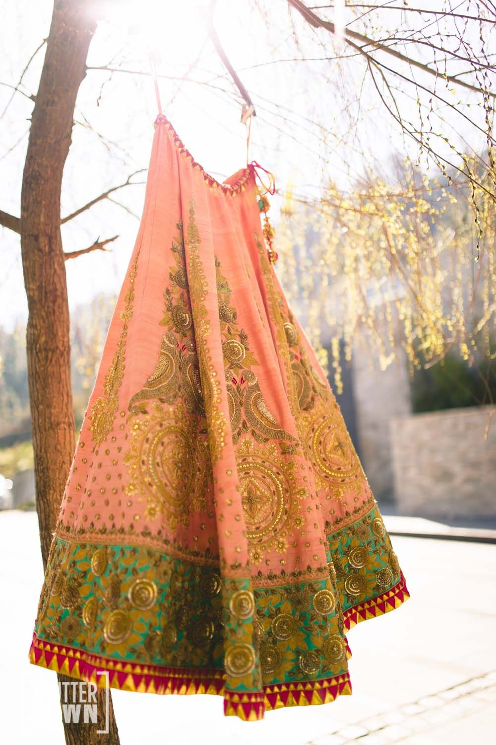 Oh my gosh this peach bridal lehenga shot by Shutter Down is so gorgeous !