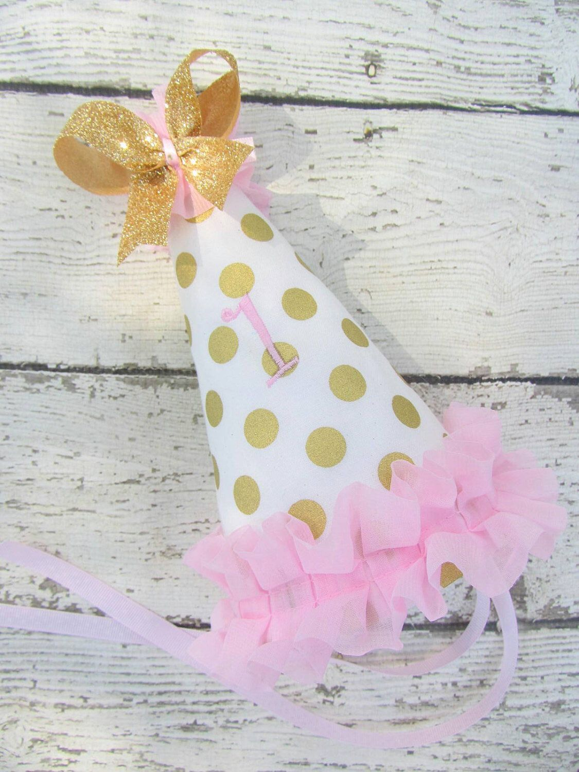 Gold Polka Dot 1st Birthday Hat with Pink Ruffle and Embroidered One and Glitter Bow Photo Prop by avannabelbaby on Etsy https://www.etsy.com/listing/250206637/gold-polka-dot-1st-birthday-hat-with