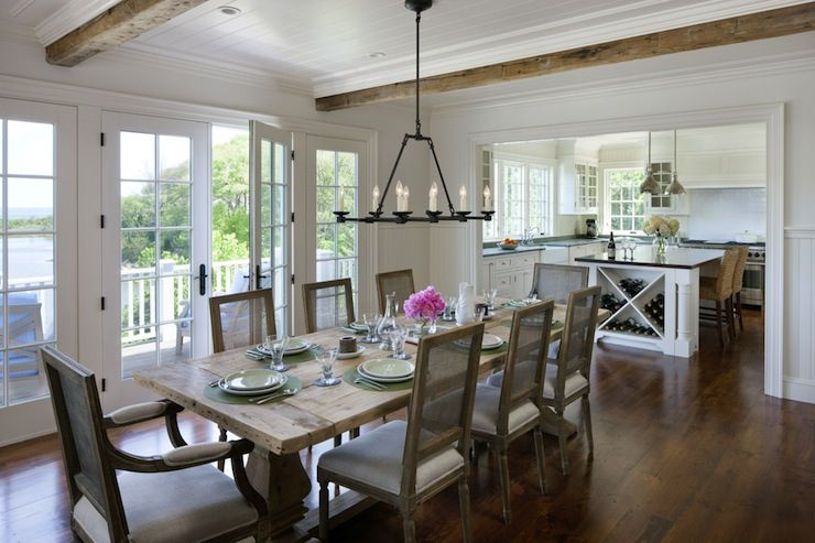 Lovely Cottage Dining Room Features Beadboard Ceiling Punctuated With Rustic Wood  Beams Punctuated With Iron Chandelier OverCottage